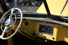 Expertly Restored steering wheel and dashboard in a 1948 Willys Overland Jeepster
