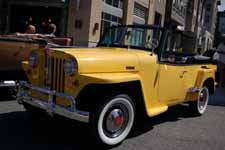 Beautifully restored 1949 Willys Overland Jeepster re-painted in factory correct Fiesta Yellow and Princeton Black colors