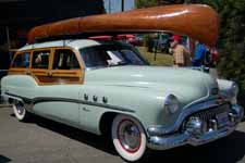 Restored 1928 Willits Brothers wood canoe and accessories on 1951 Buick Estate Wagon roof rack