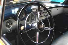 Original stock chrome horn ring and black steering wheel in 1951 Buick Estate Wagon woodie