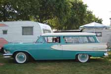 Rare 1958 Edsel Roundup 2 door Station Wagon has original Edsel full wheel covers painted turquoise to match the body