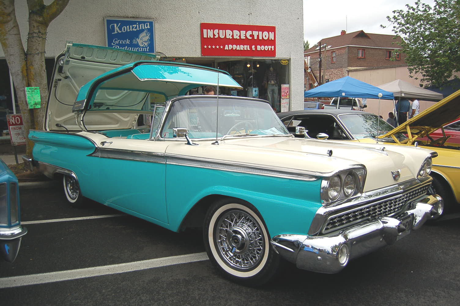 Photo of vintage 1959 ford galaxie flip top convertible showing top folding into trunk