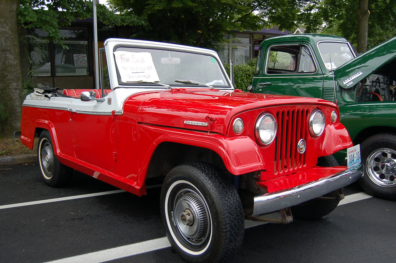 Front view shows narrow white walls and original wheel covers on a 1969 jeepster commando 1969 jeep jeepster commando