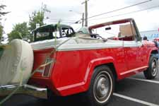 Factory stock Champagne White #432 and President Red #398 paint job on a 1969 Jeep Jeepster Commando