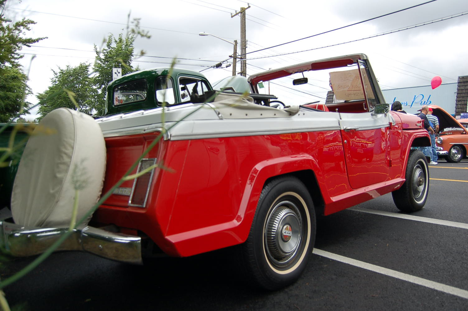 Factory stock champagne white 432 and president red 398 paint job on a 1969 1969 jeep jeepster commando
