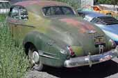 Complete and stock 1941 Buick Roadmaster coupe in classic salvage yard