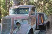 Original Ford flatbed truck in vintage storage lot