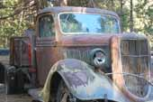 Restorable 1930's Ford truck in vintage car storage yard
