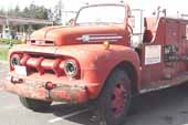Rare 1950's Ford f7 firetruck in original condition, at classic truck storage yard