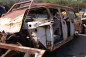 Straight 1957 Ford Country Squire station wagon project in vintage car junk yard