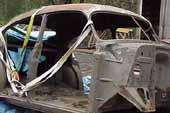 Vintage 1940's 4 door sedan project car stripped for restoration at vintage car salvage lot