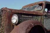 Vintage Dodge truck with great rust patina, parked in grassy field