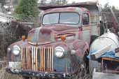 Cool original 1940's Ford farm truck in storage in classic car junk yard